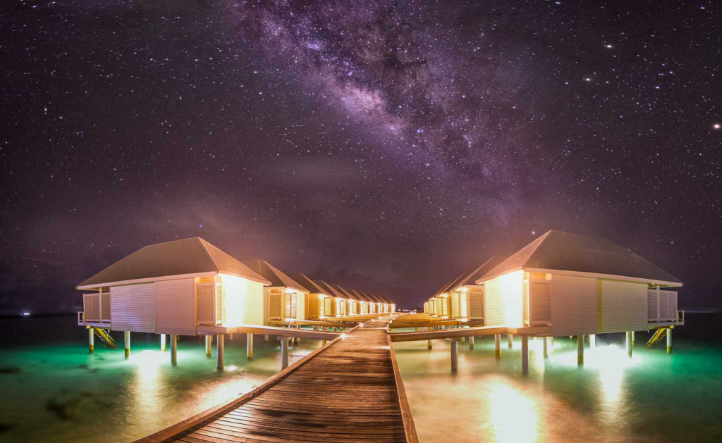 Summer_Island_Maldives_Stars_over_the_water_bungalows_1.jpg